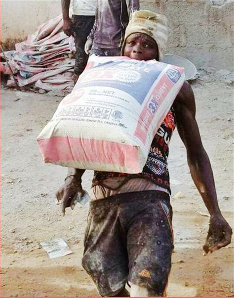 Incredible! Labourer Lifts 50kg Bag of Cement With His